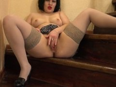 brunette with hairy by a pussy, masturbating on the stairs