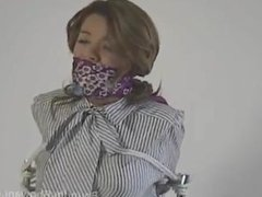 girl chair tied and scaf gagged