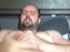 Wanking in friends bed