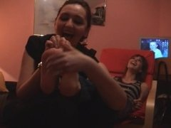 Lady has a fever for tickling sexy soles