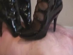 Two mistress/dominadora with latex high heels, trampling slave no mercy