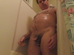 Naked man in the shower.