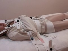 Passed out straitjacket girl