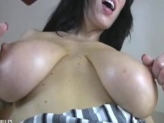 Big-titted brunette tit-fucking