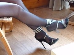high heel shoes and black pantyhosed feet
