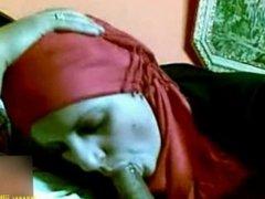 Muslim woman wearing hijab sucking and jacking cock
