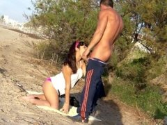Cute young spanish couple having a romantic fuck on a public beach