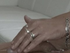 Oiled up handjob with a intense cumshot