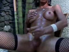 Phat assed and tanned shemale shoves papaya in tight asshole