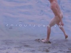 NUDE YOUNG BODY PLAYING ON THE BEACH