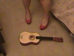 guitar destroyed under high heels