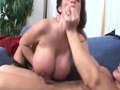 Denise Derringer Throws her huge fake tits all over Employee.