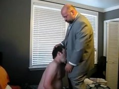 Bear in a suit gets a blowjob