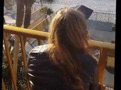 Riding dildo on hotel balcony