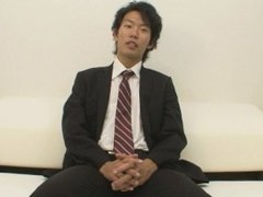 Japanese stud in suit strips down and masturbates