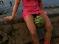 muscle girl crushes melon...easily