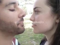 girl kiss a guy in a park