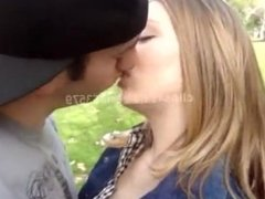 girl kiss guy in a park