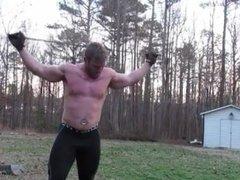 Bodybuilder Flexing and bending Steel Bars