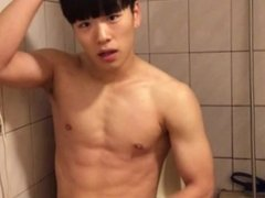 Cute Korean boy wanking in the toilet