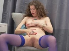 Canadian milf Janice rubs her mature pussy
