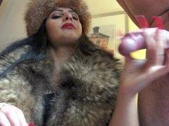 Mistress wanks off slave in fur