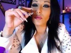 A beauty smoking a cigar