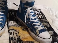 Blue Converse crush a banana on a T-Shirt