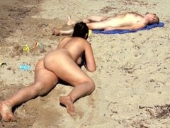 Chubby young slut playing naked on the beach and peeing on a guy