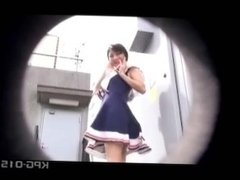 Sexy asian teen can't hide her thong when the wind blows her dress up !