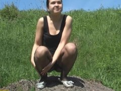The girl is pissing from a pedestal.mp4
