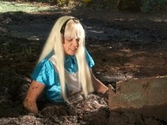 Blonde milf gets stuck in mud and struggles to escape.
