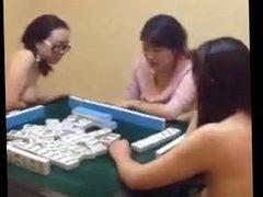 Chinese mainland women playing game of mahjong