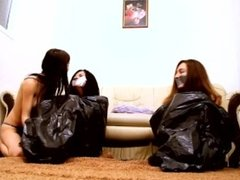 3 women and trash bags