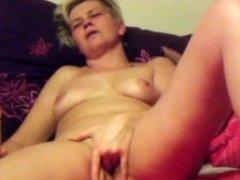 Gorgeous MILF masturbating to Orgasm