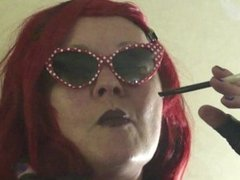 RED HAIRED JEANIE CASUALLY HOLDER SMOKING A VIRGINIA SLIM 120 MENTHOL