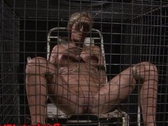 Caged slave spanked and nipple tormented