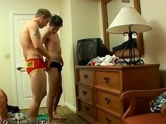 Old men in briefs wrestling each other and