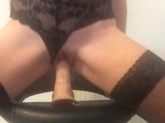 Riding dildo on a stool with lots of pussy juices