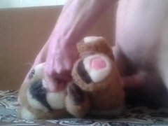 With a toy dog