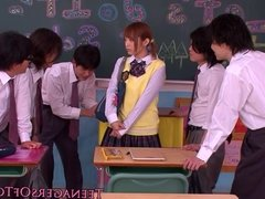 Asian teen schoolgirl giving handjob in class