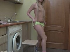 Blonde girl in knee-socks strips her clothes