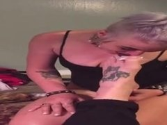 Punk rock slut eats a Reese's cup from between tattooed fuck boy's toes
