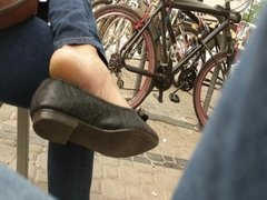 Candid girl dirty soles and feet in street