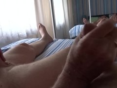 Two cocks being played with sucking