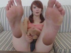 Licking her own soles