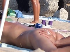 Young Woman Nude Sunbathing On The Beach