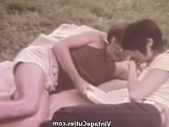Young Couple Relaxing in the Nature (1960s Vintage)