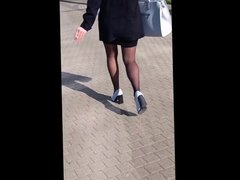 #24 Woman with sexy legs in mini skirt and black stockings