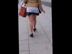 #25 Woman in very short skirt in pantyhose